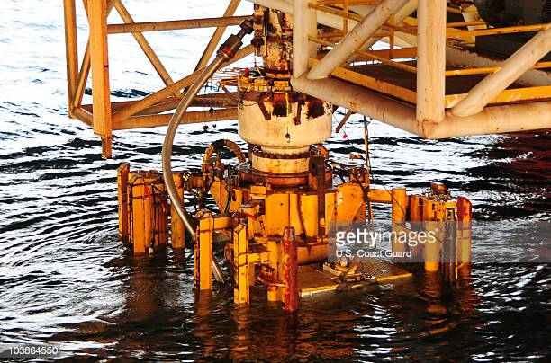 In this handout image provided by the US Coast Guard the damaged blow out preventer along with the Lower Marine Riser Package cap from the Deepwater...