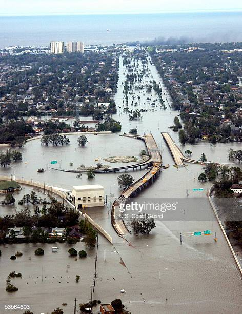In this handout image provided by the U.S. Coast Guard, water flooded roadways can be seen as the U.S. Coast Guard conducts initial Hurricane Katrina...