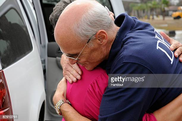 In this handout image provided by the US Department of Homeland Security Department of Homeland Security Secretary Michael Chertoff hugs Port Arthur...