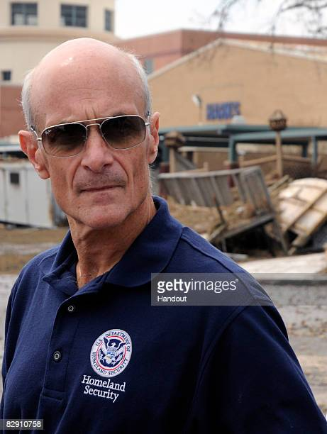 In this handout image provided by the US Department of Homeland Security Department of Homeland Security Secretary Michael Chertoff stands in front...