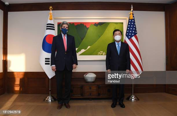 In this handout image provided by The U.S. Embassy Seoul, United States Special Presidential Envoy for Climate John Kerry pose for media with South...