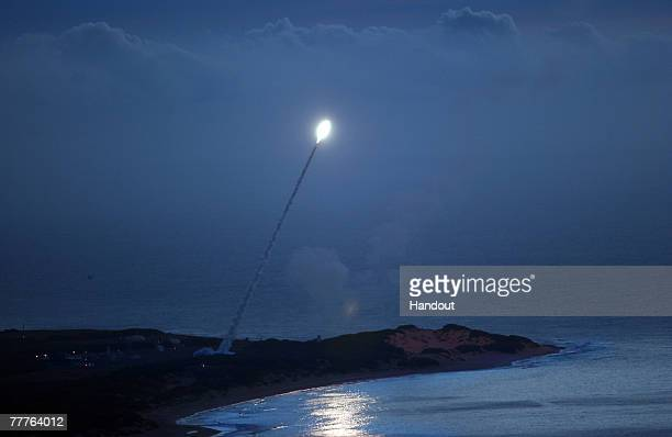 In this handout image provided by the US Navy a threat representative target is launched from the Pacific Missile Range Facility to be intercepted as...