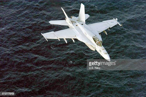 In this handout image provided by the US Navy Capt Scott Swift Commander Carrier Air Wing Fourteen flies an F/A18E Super Hornet from the 'Eagles' of...
