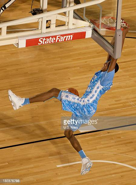 In this handout image provided by the U.S. Navy, John Henson of University of North Carolina scores during the Quicken Loans Carrier Classic...