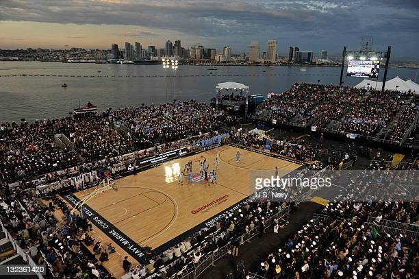 In this handout image provided by the U.S. Navy, Michigan State University and the University of North Carolina tip off the inaugural Quicken Loans...