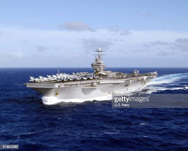 In this handout image provided by the US Navy Nimitzclass aircraft carrier USS Abraham Lincoln is underway December 21 2004 in the waters of Western...