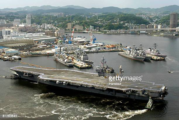 In this handout image provided by the U.S. Navy, the aircraft carrier USS Kitty Hawk departs Yokosuka, Japan for the final time May 2008. Kitty Hawk,...