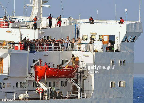In this handout image provided by the US Navy the crew of the merchant vessel MV Faina stand on the deck after a US Navy request to check on them...