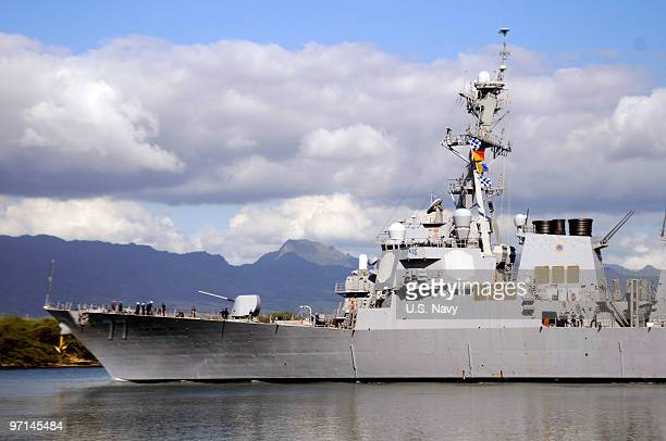 In this handout image provided by the US Navy The guidedmissile destroyer USS O'Kane makes its way out of Pearl Harbor as the state of Hawaii...