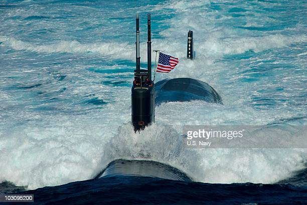In this handout image provided by the US Navy the Los Angelesclass attack submarine USS Tuscon transits the East Sea Monday July 26 2010 while...