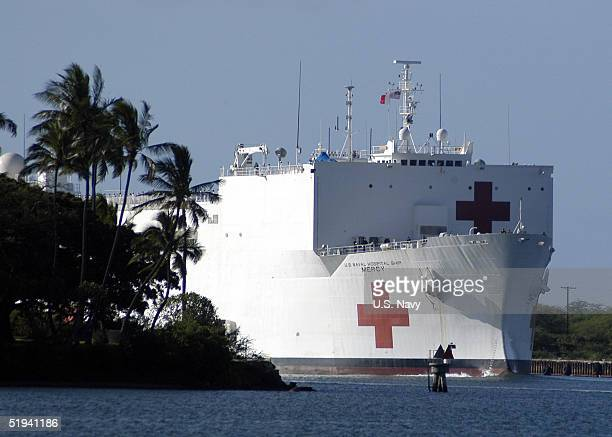 In this handout image provided by the US Navy the Military Sealift Command hospital ship USNS Mercy enters Pearl Harbor Hawaii for a brief port visit...