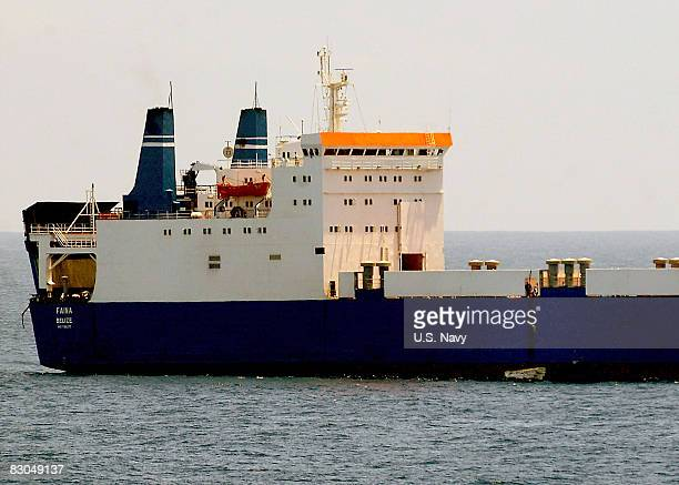 In this handout image provided by the US Navy the MV Faina one of the three pirated cargo vessels receives supplies as it is observed by the...