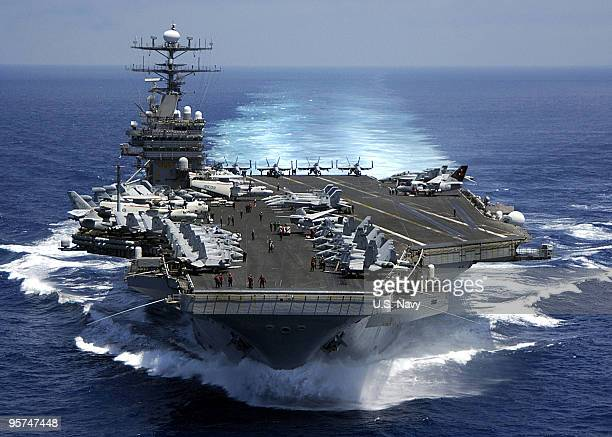 In this handout image provided by the U.S. Navy, the Nimitz-class aircraft carrier USS Carl Vinson March 15, 2009 in the Indian Ocean. Carl Vinson is...