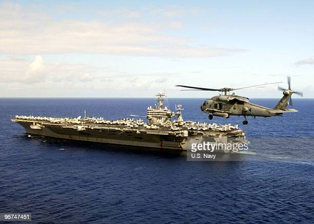 In this handout image provided by the US Navy the Nimitzclass aircraft carrier USS Carl Vinson departs Naval Station Mariannas Guam after a fourday...