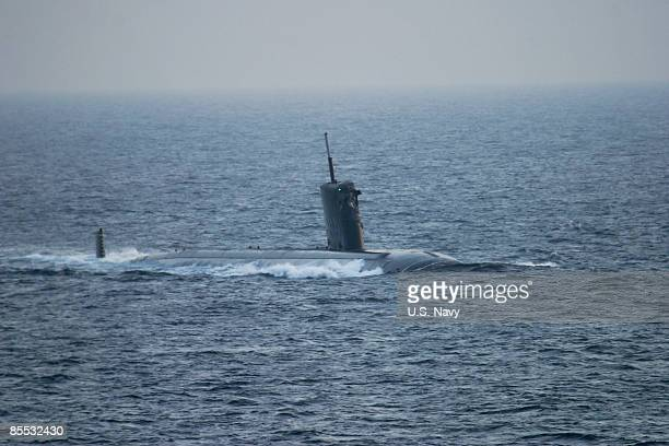 In this handout image provided by the US Navy the nuclearpowered fast attack Los Angelesclass submarine USS Hartford is back underway after a...