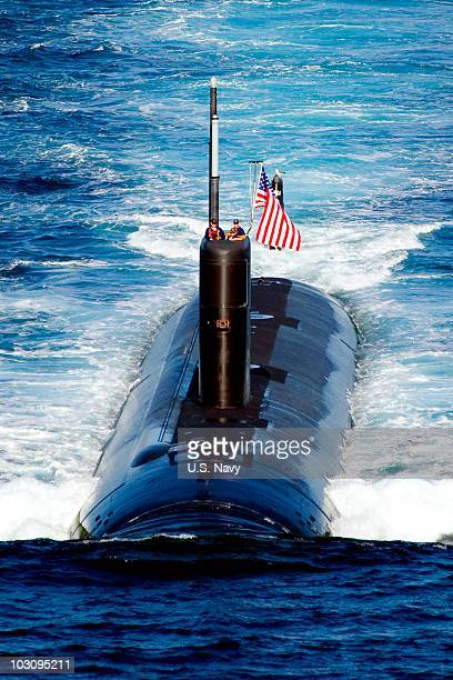 In this handout image provided by the US Navy the US Navy Los Angelesclass attack submarine USS Tuscon leads a 13ship formation as it sails on July...