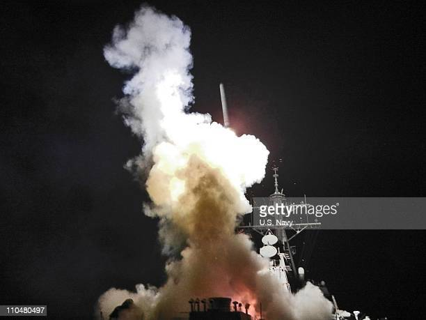 In this handout image provided by the US Navy The USS Barry launches a Tomahawk missile in support of Operation Odyssey Dawn March 19 2011 This was...