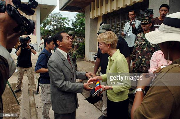 In this handout image provided by the U.S. Navy, U.S. Ambassador to the Philippines Kristie A. Kenney meets with a government official from the Trial...