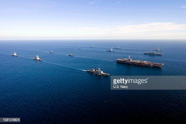 In this handout image provided by the US Navy US Navy and South Korean ships sail in a 13ship formation on July 26 2010 in the East Sea off of the...