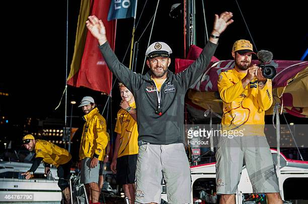 In this handout image provided by the Volvo Ocean Race Ian Walker skipper Abu Dhabi Ocean Racing celebrates second place of Leg 4 from Sanya on...