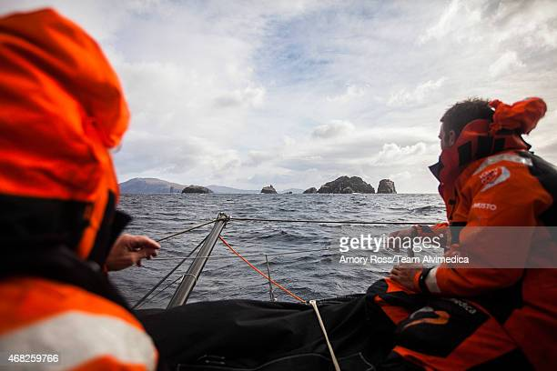In this handout image provided by the Volvo Ocean Race Leg 5 to Itajai onboard Team Alvimedica Day 13 Nick Dana and Will Oxley look at the islands of...