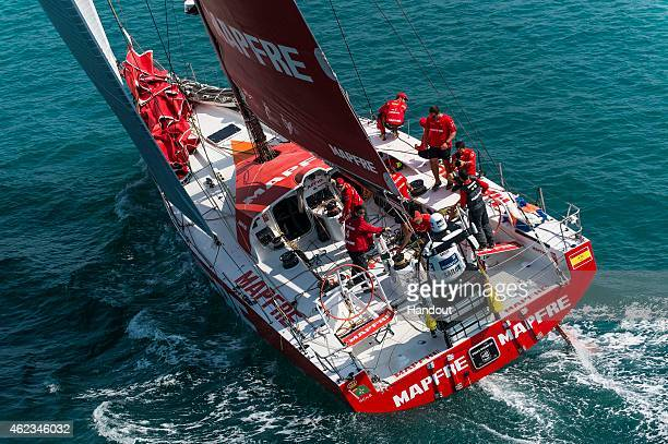 In this handout image provided by the Volvo Ocean Race MAPFRE arrives in Sanya in fourth position after 23 days of sailing between Abu Dhabi UAE and...