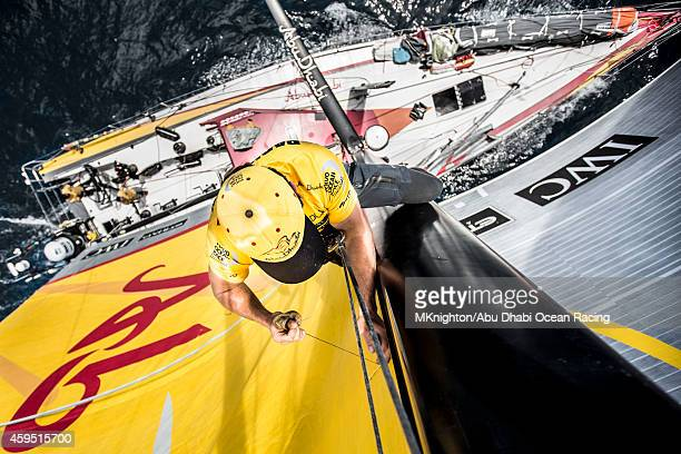 In this handout image provided by the Volvo Ocean Race onboard Abu Dhabi Ocean Racing Taking advantage of the light winds Luke Parkinson went up the...