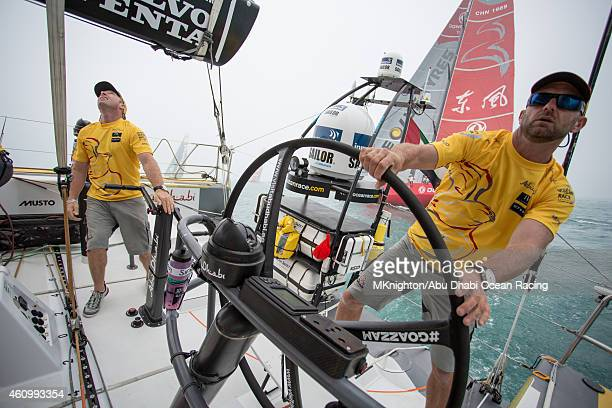 In this handout image provided by the Volvo Ocean Race Onboard Abu Dhabi Ocean racing Ian Walker at the helm as the team make a great start during...