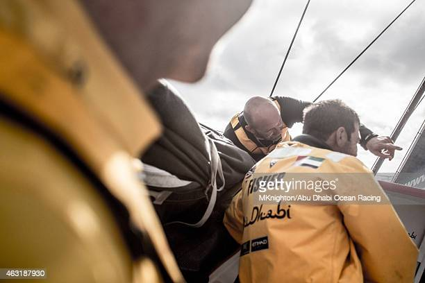 In this handout image provided by the Volvo Ocean Race onboard Abu Dhabi Ocean Racing Ian Walker and Simon SiFi Fisher compare modes with Dongfeng in...