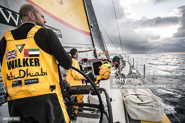 In this handout image provided by the Volvo Ocean Race onboard Abu Dhabi Ocean Racing Ian Walker looks over his shoulder at Dongfeng in the Straights...