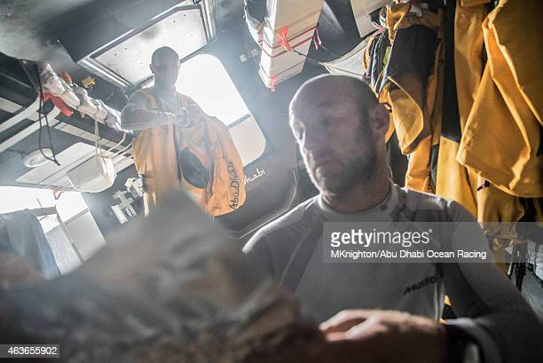 In this handout image provided by the Volvo Ocean Race onboard Abu Dhabi Ocean Racing Ian Walker offers Phil Harmer his choice of the luxurious food...