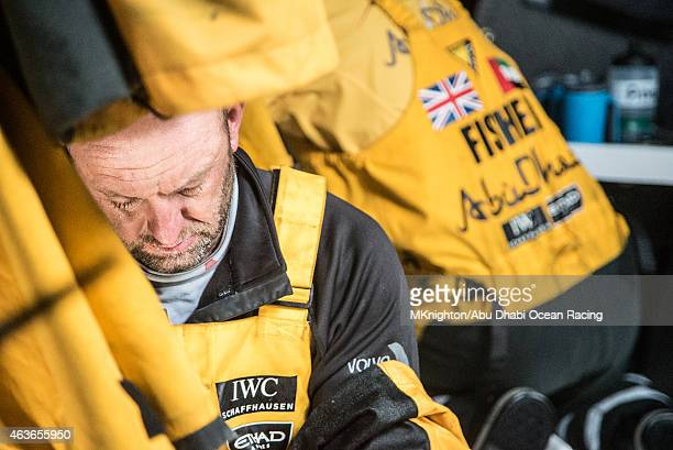 In this handout image provided by the Volvo Ocean Race onboard Abu Dhabi Ocean Racing Ian Walker takes his foul weather gear off after watch during...