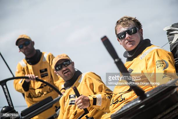 In this handout image provided by the Volvo Ocean Race onboard Abu Dhabi Ocean Racing Alex Higby Phil Harmer and Ian Walker sit to windward as Azzam...