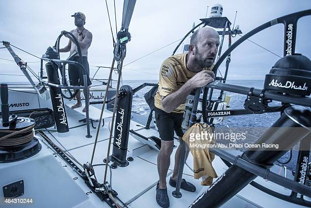 In this handout image provided by the Volvo Ocean Race onboard Abu Dhabi Ocean Racing With the rain squall dispersing Ian Walker stares to leeward as...