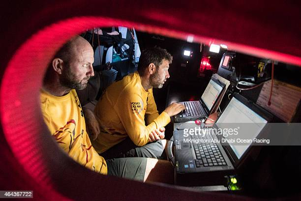 In this handout image provided by the Volvo Ocean Race onboard Abu Dhabi Ocean Racing Ian Walker and Simon SiFi Fisher review the latest sked in the...