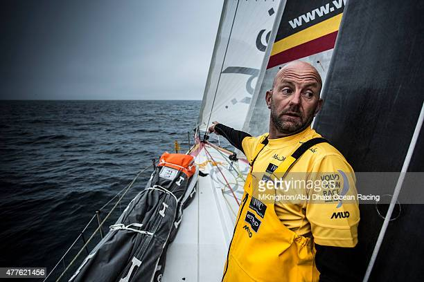 In this handout image provided by the Volvo Ocean Race onboard Abu Dhabi Ocean Racing Day 1 Ian Walker on the lookout for patches of seaweed that...