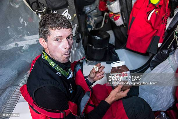 In this handout image provided by the Volvo Ocean Race onboard Dongfeng Race Team Thomas Rouxel the happiest sailor on the boat when he has his daily...