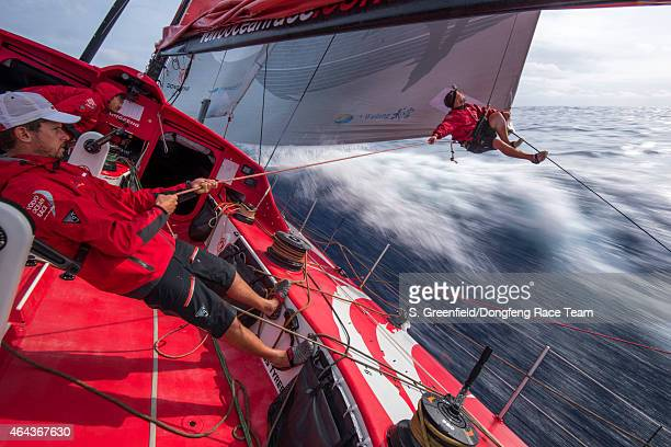 In this handout image provided by the Volvo Ocean Race onboard Dongfeng Race Team Kevin Escoffier inspects the leech line on the MH0 during Leg 4...
