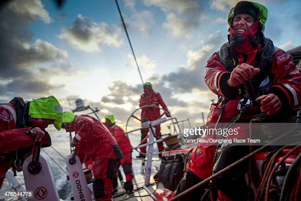 In this handout image provided by the Volvo Ocean Race onboard Dongfeng Race Team Martin Strmberg shows the hard work involved with tacking in 30...