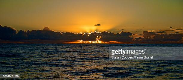 In this handout image provided by the Volvo Ocean Race onboard Team Brunel A quiet Indian Ocean sunset during Leg 2 between Cape Town South Africa...