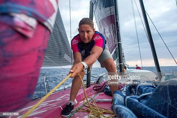 In this handout image provided by the Volvo Ocean Race onboard Team SCA Dee Caffari unfurls the staysail during Leg 2 between Cape Town South Africa...