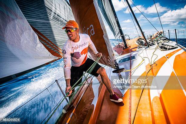 In this handout image provided by the Volvo Ocean Race onboard Team Alvimedica Nick Dana on the bow during a sail change from the Masthead Code Zero...