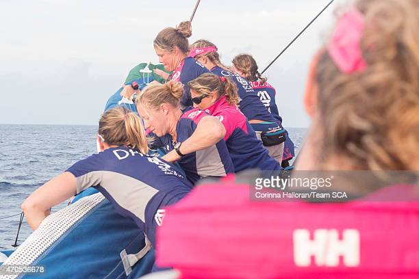 In this handout image provided by the Volvo Ocean Race onboard Team SCA Carolijn Brouwer helms while the rest of the team puts the J1 back on the...