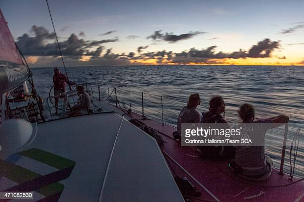 In this handout image provided by the Volvo Ocean Race onboard Team SCA Day 4 Annie Lush Stacey Jackson and Abby Ehler have a chat on the rail as...