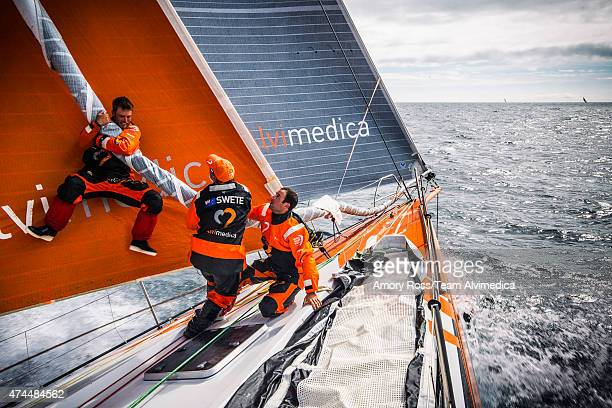 In this handout image provided by the Volvo Ocean Race onboard Team Alvimedica Nick Dana leaps onto the furled Fractional Code Zero in an attempt to...