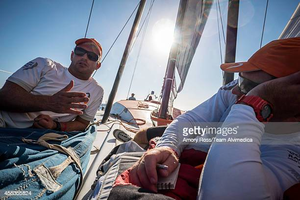 In this handout image provided by the Volvo Ocean Race Ryan Houston and Charlie Enright conduct a thorough performance debrief of the first day's...