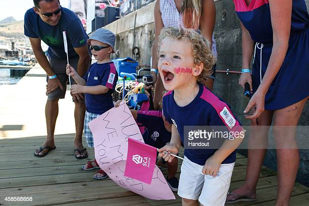 In this handout image provided by the Volvo Ocean Race Team SCA arrives to the pontoon in Cape Town after completing Leg 1 and Carolijn Brouwer's kid...