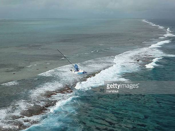 In this handout image provided by the Volvo Ocean Race Team Vestas Wind's boat grounded on the Cargados Carajos Shoals Mauritius in the Indian Ocean...