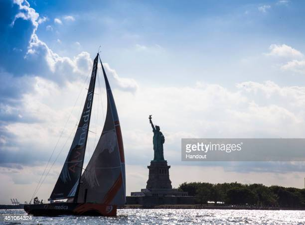 In this handout image provided by the Volvo Ocean Race Team Alvimedica with American skipper Charlie Enright of Bristol RI arrive from Newport RI in...