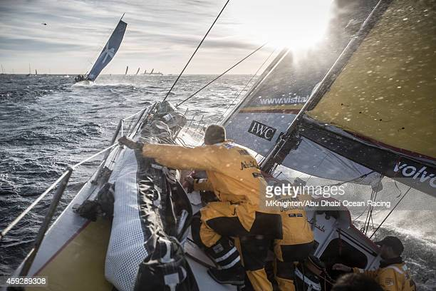 In this handout image provided by the Volvo Ocean Race the crew of Abu Dhabi Ocean Racing work hard to get themselves out of the bay with ever...